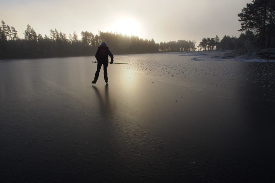 on the black smooth ice