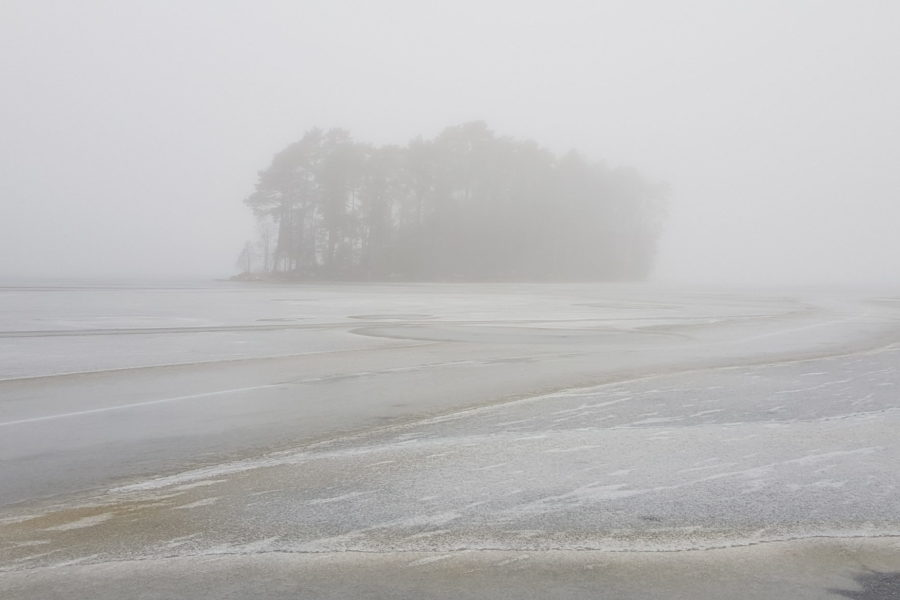 island embedded in mist