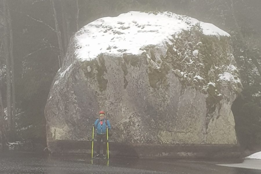 big boulder, small man on skates