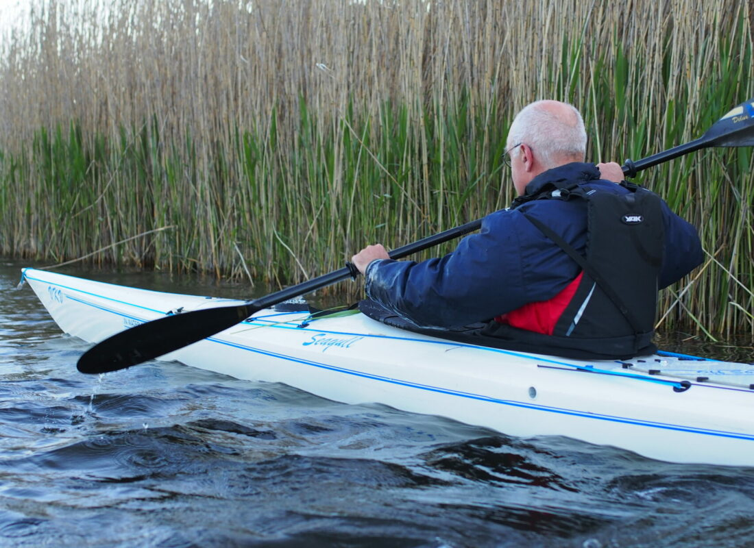 Along the reeds in single kayak