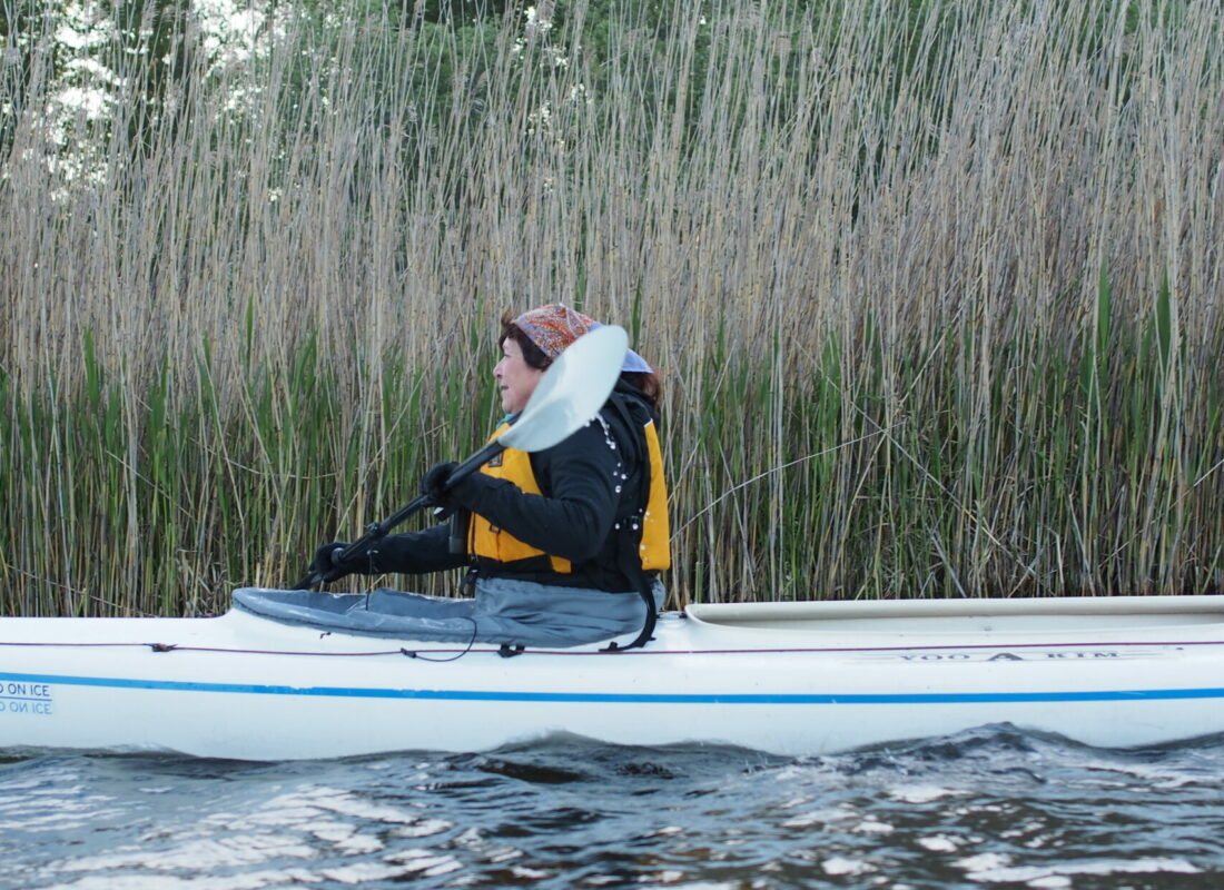 Paddling in the front of a tandem kayak